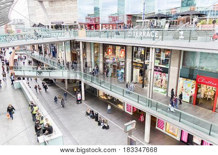 LIVERPOOL, ENGLAND - APRIL 3, 2017: People walking in the Liverpool One shopping centre. The place is the largest open air shopping centre in the United Kingdom and the 5th largest overall.