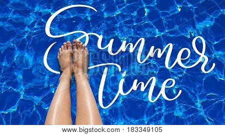 legs girl on a background of pool water and text Summer time. Calligraphy lettering hand draw.