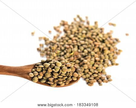 Lentils on wooden spoon isolated. Lentil Corn