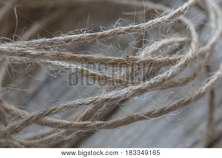 Twisted twine cord macro, isolated on wooden background