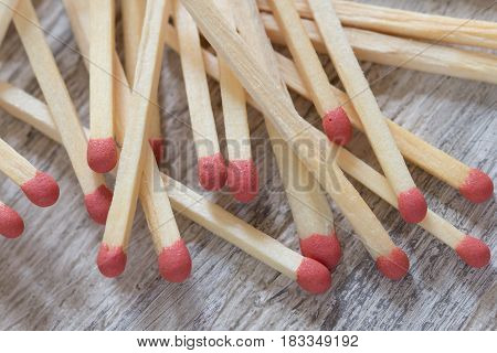 Heap of matches on wooden surface, close-up
