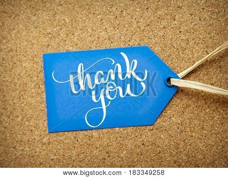 blue sticker sale on the cork background and text Thank you. Calligraphy lettering hand draw.