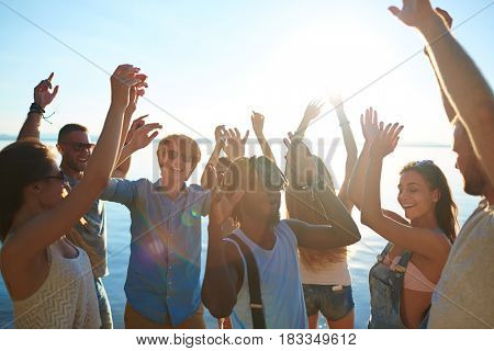 Happy young dancers having hangout on the beach