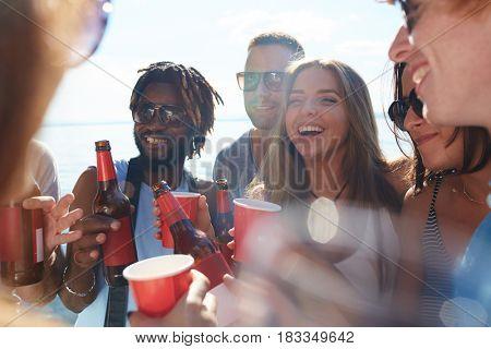 Cheerful buddies having fun on the beach