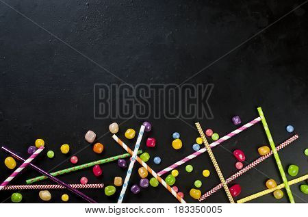 Cocktail Straw And Mini Candy On A Black Background, Top View,