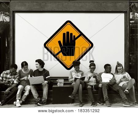 Group of Friends Sitting Together with Don't Touch Caution Banner Behind