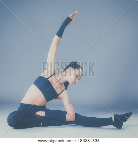 Portrait of sport girl doing stretching exercise.