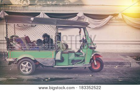 An unidentified driver tuk-tuk waiting customers on road