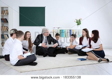 Senior teacher conducting lesson at school