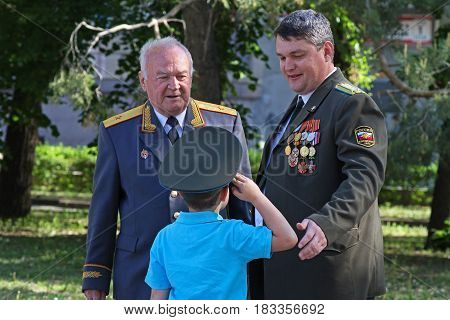 Volgograd Russia - May 09 2013: The boy in the cap saluting seniors in rank on Victory day in Volgograd