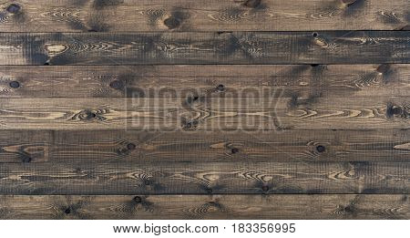 Dark wood texture background surface with old natural pattern. Grunge surface rustic wooden table top view
