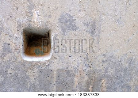Hole on Cement Wall Background. Suitable for Presentation and Web Templates with Space for Text.