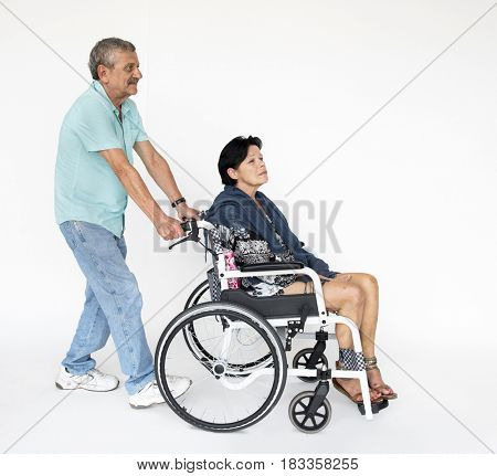 Man and woman sitting on wheelchair