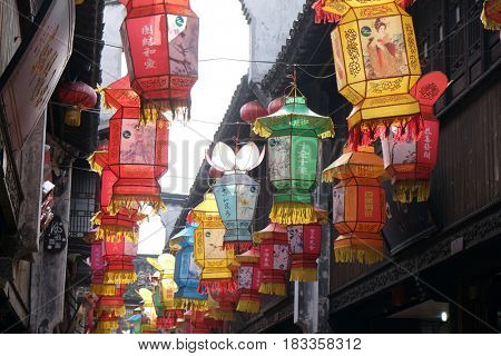 JIAXING - FEBRUARY 20: Traditional Chinese lanterns in the streets along the Grand Canal, ancient town of Yuehe in Jiaxing, Zhejiang Province, China, February 20, 2016.