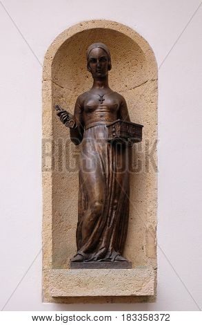ZAGREB, CROATIA - DECEMBER 12: Statue of Dora Krupic, a character from the novel Goldsmith's Gold (1871) by August Senoa, placed in a niche at upper town in Zagreb, on December 12, 2015.