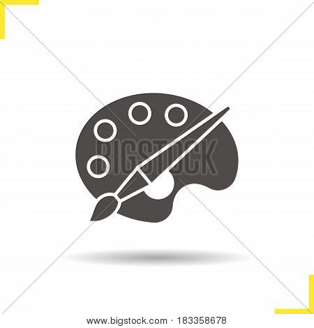 Palette with brush glyph icon. Drop shadow silhouette symbol. Art school logo. Negative space. Vector isolated illustration