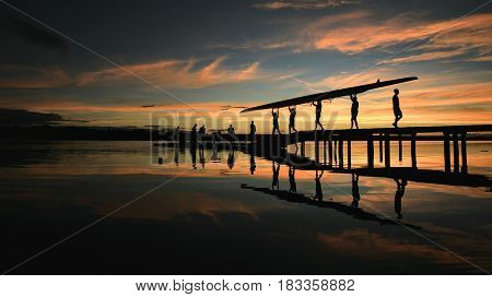 Rowers carrying boat at sunrise in Brasilia