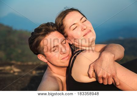 Loving Couple On Top Of A Mountain.