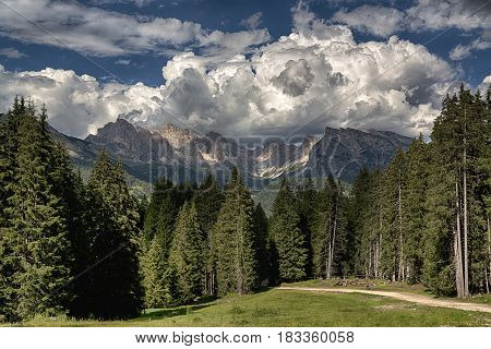 Summer landscape in the italian alps with clouds over the Odle mountains Dolomiti - Trentino-Alto Adige