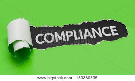 Torn green paper revealing the word Compliance