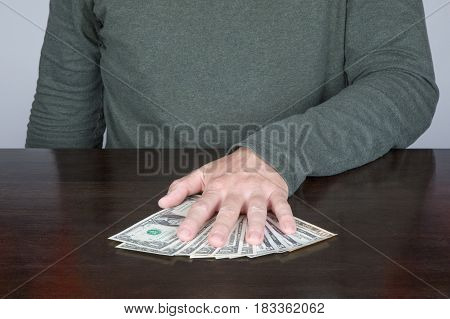 Hand Of Man Holding A Bundle Of Dollars