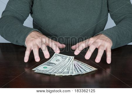 Hands Of Man Ready To Catch A Bundle Of Dollars