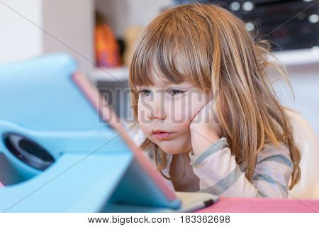 Little Child Watching Digital Tablet