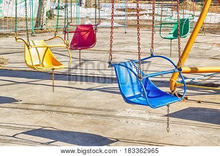 Ferris wheel-yellow with multi-colored booths on a white background