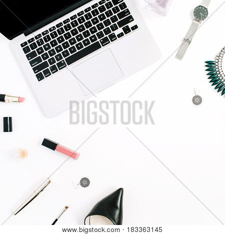 Beauty blog concept. Female clothes and accessories: watches necklace lipstick shoes sunglasses laptop on white background. Flat lay top view trendy fashion feminine background.