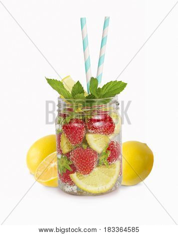 strawberry lemonade with lemon slices. Drinks in a glass jar with mint. Homemade lemonade isolated on white background. Drinks for a party. Refreshing drink with striped straw