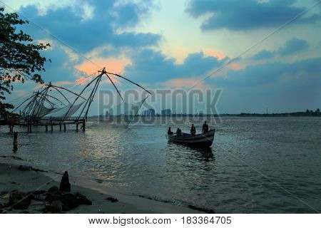 Fishermen Are Throwing Chinese Nets In Fort Kochi.