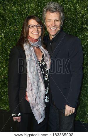 NEW YORK-APR 24: Dorothea Bongiovi (L) and husband Jon Bon Jovi attend the 12th Annual Tribeca Film Festival Artists Dinner hosted by Chanel at Balthazar Restaurant on April 24, 2017 in New York City.