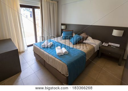 MALEME,GREECE - APRIL 2, 2017: Luxury interior of Ledra Maleme hotel in Maleme town on Crete, Greece. Ledra Maleme is traditional greek hotel with beautiful architecture in Chania region of Crete.