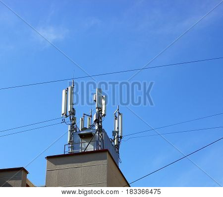 4G Cell site radio towers or mobile phone base station. Against the blue sky
