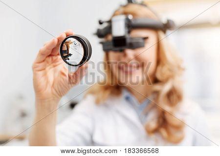 Medical manipulation. Dedicated thorough wonderful ophthalmologist receiving a visit from her patient and running a regular diagnostic procedure
