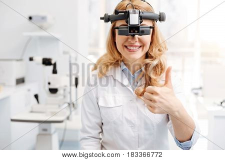 Making my work easier. Learned neat distinguished ophthalmologist wearing professional equipment for indicating eyesight problems and diagnosing patients
