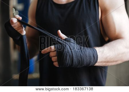 Close up of strong hands of boxer in gloves