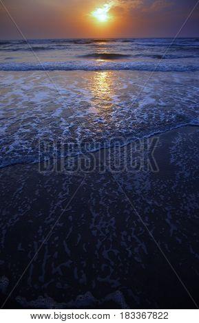 Sunset at Atlantic Ocean. Vertical colorful photo