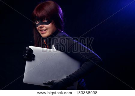 Brunette thief in black gloves