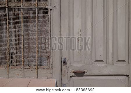 Detail Of An Old Taupe Wooden Door And Window