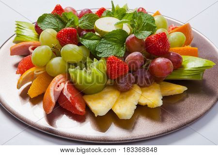 Mixed Fruit Platter With Assorted Fruits On A White Background