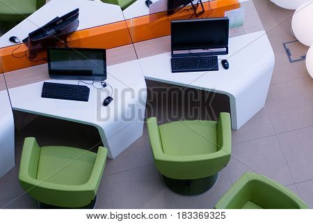 Top View Of The Workplace With Computers