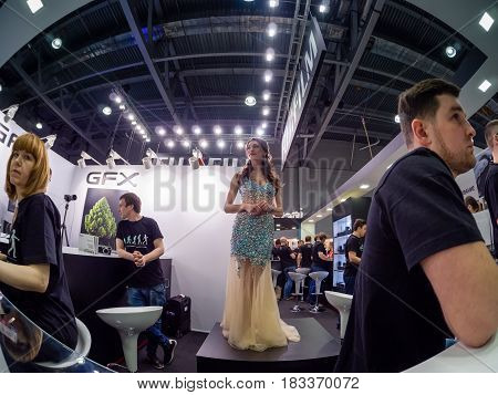 PhotoForum Moscow Russia Fujifilm Instax girl mini square business people exhibition crowd industry kiosk stall event photo video digital camera equipment product imaging pavilion stand spectator design marketing men women indoors booth customer sign grou