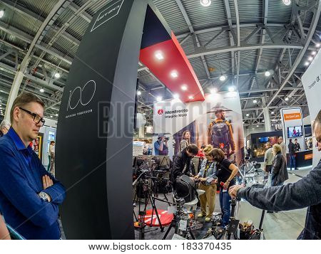 MOSCOW RUSSIA - APRIL 21 2017: Booth of Gitzo and Manfrotto companies at PhotoForum 2017 trade show and exhibition in Moscow Russia on April 21 2017.