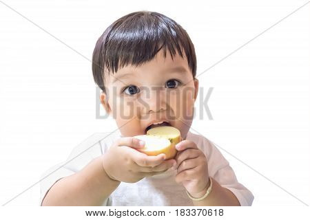 Happy boy with bangs hairstyle enjoy eating apple on white background