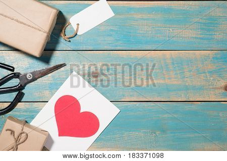 Love Greeting Card Over Wooden Background. Top View With Copy Space