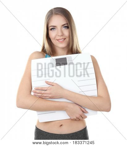 Diet concept. Young beautiful woman holding scale on white background