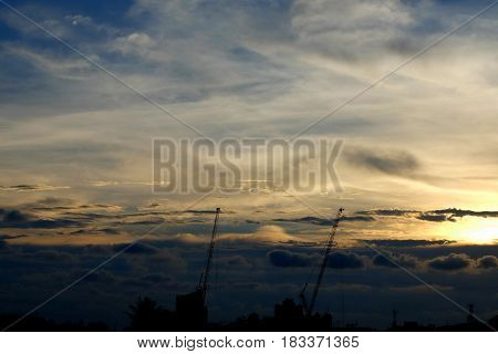 Silhouette of Crane in Sunset Scenery Background with Space for Space Text.