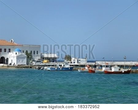Blue Sky and Sea with Greek Island Style Church at the Old Port of Mykonos Island, Greece