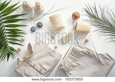Composition with spa uniform on white background